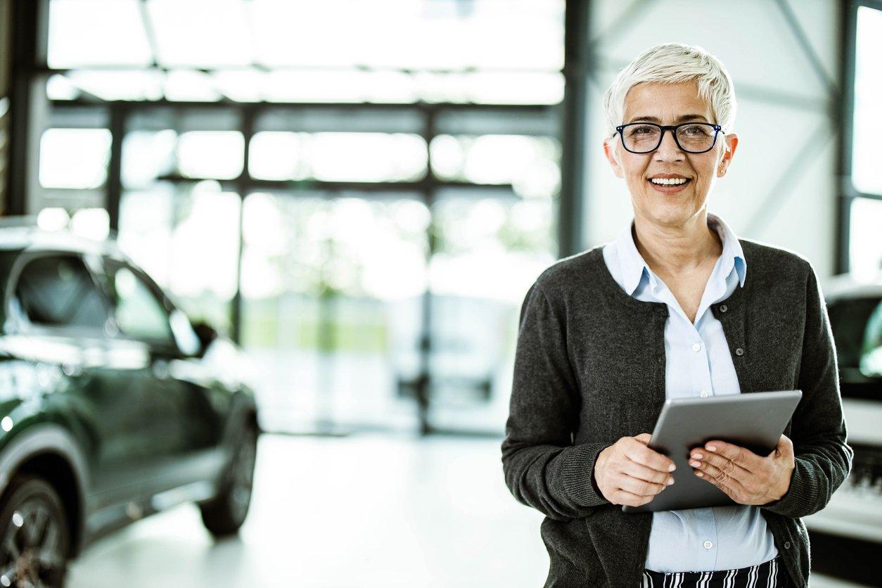 woman smiling at camera automotive dealership
