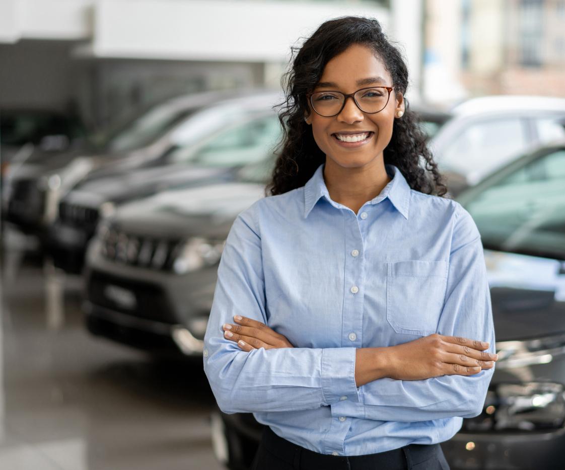 person at automotive dealership